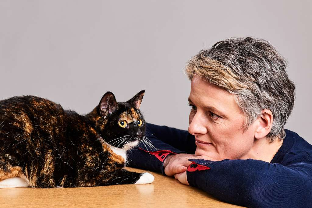 Rachel Perry looking at Cat Wide